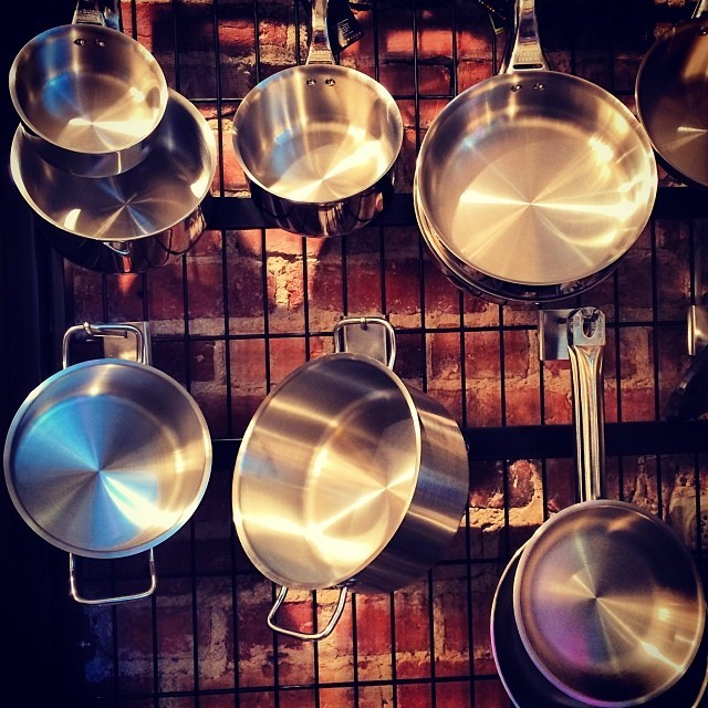 Picture of pots and pans hanging - by @michaelambjorn